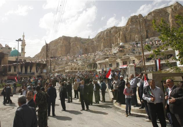 Residents are seen in Maaloula town, northeast of Damascus