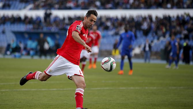 Benfica's Jonas Oliveira shoots to score his second goal against Belenenses during their Portuguese Premier League soccer match at Restelo stadium in Lisbon