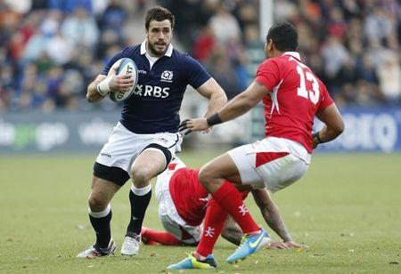 Scotland's Dunbar takes on Tonga's Piutau during their Autumn International rugby union match in Kilmarnock