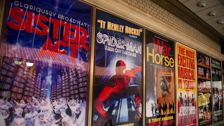 "FILE- This Jan. 19, 2012 file photo shows posters advertising Broadway shows, including the now closed ""Sister Act,"" are displayed in Shubert Alley, in New York. The percentage of minority actors working on Broadway and at the top 16 not-for-profit theater companies in New York City rose to 23 percent during the 2011-2012 season. (AP Photo/Charles Sykes, file)"