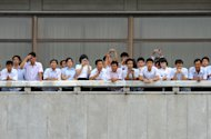 North Korean tourists, on a balcony, look toward the South side at the truce village of Panmunjom in the demilitarized zone separating the two Koreas on Wednesday July 27, 2011 as U.N. and U.S. military officers visited Panmunjom to mark the 58th anniversary of the cease-fire of the 1950-53 Korean War. (AP Photo/Kim Jae-hwan, Pool)
