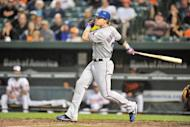 Josh Hamilton of the Texas Rangers hits a two-run home run in the third inning during the game against the Baltimore Orioles on May 8. Hamilton hit four home runs to become the 16th player in Major League Baseball history to accomplish the feat