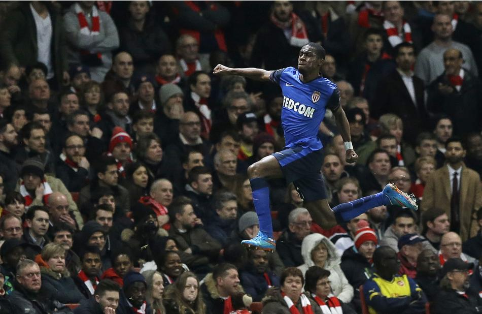 Monaco's Geoffrey Kondogbia celebrates after scoring the opening goal during the Champions League round of 16 soccer match between Arsenal and AS Monaco at the Emirates Stadium in London, Wednesda