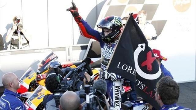 Motorcycling - Lorenzo wins in Japan to set up title-deciding finale