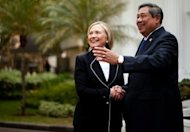 Hillary Clinton (L) shakes hands with Indonesian President Bambang Susilo Yudhoyono before a bilateral meeting at the Presidential Palace in Jakarta. Clinton then left for Beijing, where she voiced hopes for progress in managing increasing tensions in the South China Sea