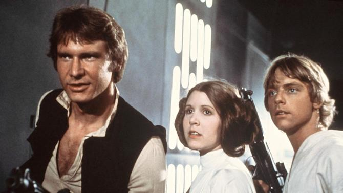 "FILE - This 1977 file image provided by 20th Century-Fox Film Corporation ahows, from left, Harrison Ford, Carrie Fisher, and Mark Hamill in a scene from ""Star Wars"" movie released by 20th Century-Fox in 1977. Having recently purchased the ""Star Wars"" franchise from Lucasfilm for $4 billion, the Walt Disney Co. is shifting the films into hyperdrive. Not only has Disney already begun working on a new trilogy, to start with J.J. Abrams directing episode seven, but reports this week have said possible spinoffs are being developed for young Han Solo, the bounty hunter Boba Fett and Yoda.  (AP Photo/20th Century-Fox Film Corporation)"