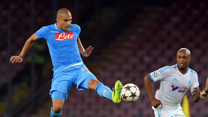 Napoli's Gokhan Inler reaches for the ball during a Champions League, group F, soccer match between Napoli and Marseille, at the Naples San Paolo stadium, Italy, Wednesday, Nov. 6, 2013