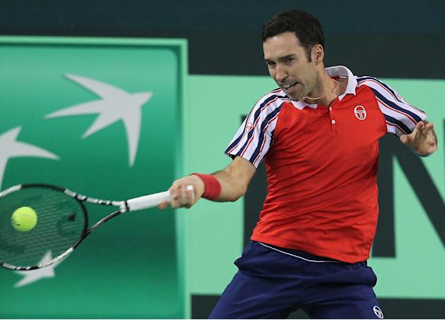 Kazakhstan's Mikhail Kukushkin in action against Simone Bolelli of Italy during their Davis Cup World Group first round match in Astana on March 6, 2015