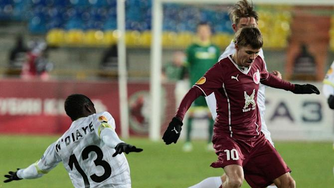 Rubin Kazan's Dmitri Torbinski, right, and Zulte Waregem player Mamatou N'Diaye fight for the ball during their Europa League Group D soccer match in Kazan, Russia, Thursday, Oct. 3, 2013
