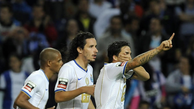 """FC Porto's Josue Pesqueira, right, celebrates with Luis """"Lica"""" Carneiro, center, and Fernando Reges, from Brazil, after scoring against Vitoria Guimaraes in a Portuguese League soccer match at the Dragao Stadium in Porto, Portugal, Friday, Sept. 27, 2013"""
