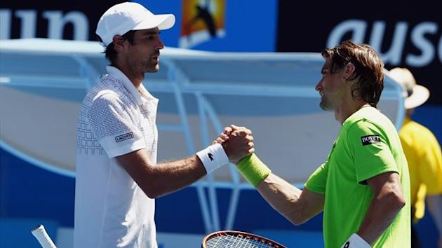 David Ferrer (R) of Spain shakes hands with Jeremy Chardy of France (Reuters)
