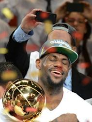 NBA Finals MVP LeBron James of the Miami Heat holds the championship trophy after defeating the Oklahoma City Thunder in Game Five of the NBA Finals in Miami, Florida. The Heat won 121-106 to capture the best-of-seven championship series four games to one