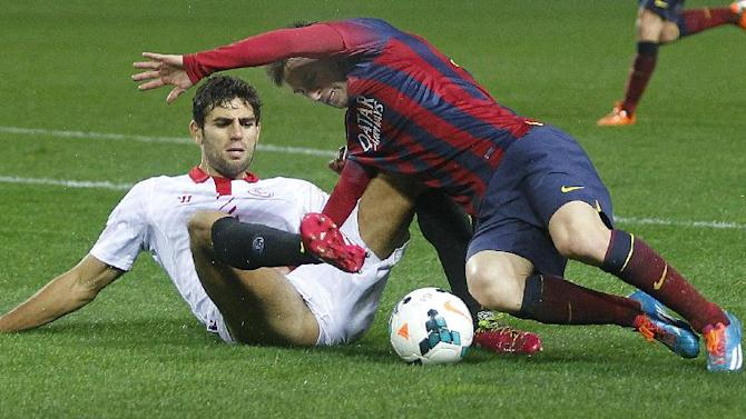 Barcelona's Lionel Messi, right, and Sevilla's Federico Fazio from Argentina, fight for the ball during their La Liga soccer match at the Sanchez Pizjuan stadium, in Seville, Spain on Sunday, Feb. 9, 2014