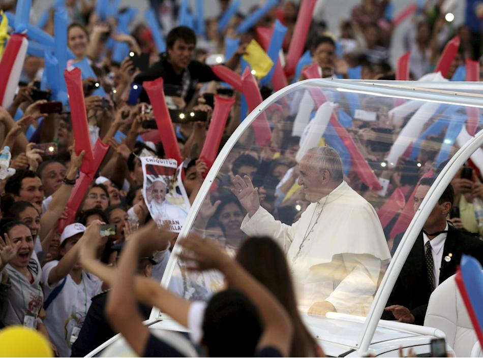 Pope Francis waves as he arrives to meet with youths in Asuncion, Paraguay