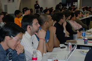 Attentive crowd of more than 100 engineers