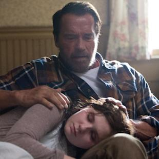 "In this image released by Roadside Attractions, Abigail Breslin, foreground, and Arnold Schwarzenegger appear in a scene from ""Maggie."" (Tracy Bennett/Roadside Attractions via AP)"