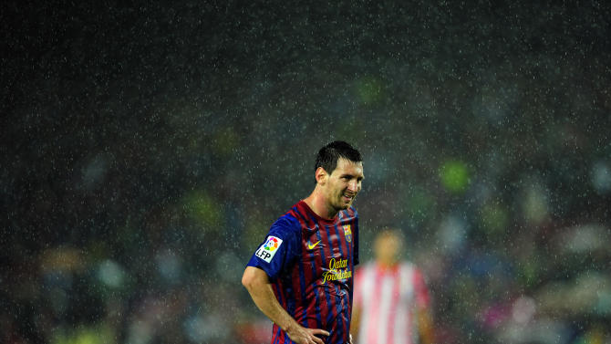 FC Barcelona's Lionel Messi, from Argentina, reacts during a Spanish La Liga soccer match against Atletico Madrid at the Camp Nou stadium in Barcelona, Spain, Saturday, Sept. 24, 2011. (AP Photo/Manu Fernandez)