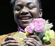 Claressa Shields of the USA holds her gold medal during the awards ceremony for the women's boxing Middleweight category of the 2012 London Olympic Games at the ExCel Arena in London