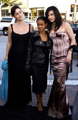 Premiere: Carrie Anne Moss daydreams about ponies and butterflies with Jada Pinkett Smith and Monica Bellucci at the Hollywood premiere of Warner Brothers' The Matrix: Reloaded - 5/7/2003