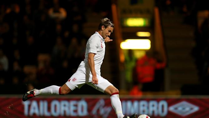 England's Craig Dawson scores from the penalty spot against Serbia in the only goal of the first leg tie