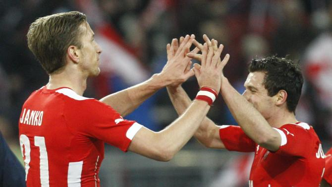 Austria's Janko and Junuzovic celebrate after scoring a goal during their international friendly soccer match against Uruguay in Klagenfurt