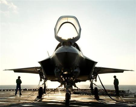 The flight deck crew secures an F-35B Lighting II aircraft aboard the amphibious assault ship USS Wasp following testing in this handout photo taken off the coast of North Carolina August 24, 2013. REUTERS/U.S. Navy/Handout