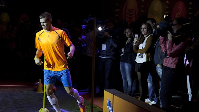 Real Madrid's Gareth Bale takes part in a soccer boot promotional event in Madrid, Spain. Thursday Nov. 21, 2013