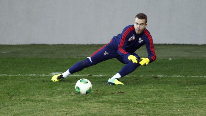 Russia's national team goalkeeper Akinfeev attends a training session ahead of their 2014 World Cup qualifying soccer match against Azerbaijan in Baku