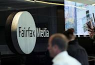 """A man walks past signage in the foyer of the Sydney office of Fairfax Media on June 18, 2012. One of Fairfax Media's largest shareholders warned Wednesday that the Australian firm's flagship titles faced closure without a major turnaround, describing them as """"worth less than nothing"""""""