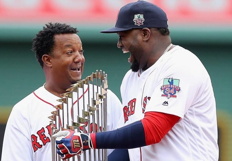 Pedro Martinez (left) and David Ortiz share the World Series trophy during a ceremony celebrating Ortiz's career. (Getty Images)