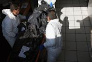 Forensic technicians carry on a trolley into the morgue part of the 15 corpses found earlier in two abandoned vehicles on the highway to Chapala, 45 kms of Guadalajara, Mexico. Police found the dismembered, decapitated bodies of 15 people in two abandoned vehicles in western Mexico Wednesday in an apparent revenge killing between powerful drug gangs