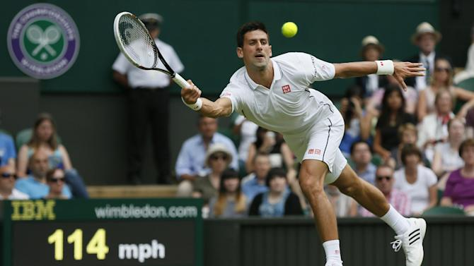 Wimbledon men - Djokovic shows class to demolish Tsonga