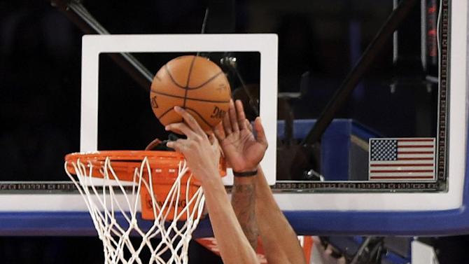 New York Knicks' Amar'e Stoudemire, left, blocks a shot by Milwaukee Bucks' Giannis Antetokounmpo during the second quarter of an NBA basketball game at New York's Madison Square Garden, Saturday, March 15, 2014