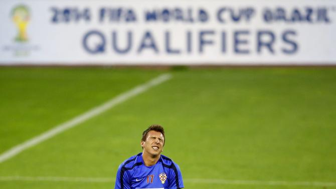 Croatia's Mandzukic grimaces during a training session in Belgrade