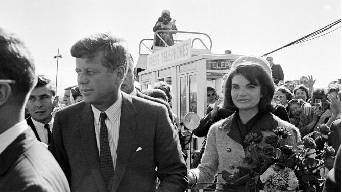 "FILE - This Nov. 22, 1963 file photo shows President John F. Kennedy and his wife Jacqueline Kennedy upon their arrival at Dallas Airport, in Dallas, shortly before President Kennedy was assassinated. PBS says its fall schedule will include a variety of specials marking President John F. Kennedy's death 50 years ago. In the weeks leading up to the milestone anniversary of his Nov. 22, 1963, slaying in Dallas, PBS said it will air ""JFK,"" a four-hour ""American Experience"" special.  (AP Photo, file)"