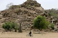 A Sudanese soldier rides a bicycle during a patrol following clashes between the army and South Sudan's forces in the town of Talodi in South Kordofan. The leaders of Sudan and South Sudan accused each other on Thursday of wanting war, with each denying the other's charge, as Sudanese war planes bombed a bridge in the South after days of fighting in a contested border region