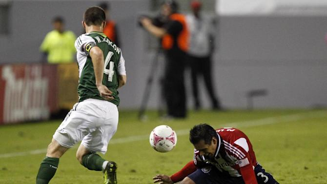 Portland Timbers midfielder Will Johnson (4) steals the ball from Chivas USA defender Mario de Luna, right, during the second half of an MLS soccer match, Saturday, Oct. 26, 2013, in Carson, Calif. Timbers won the match 5-0
