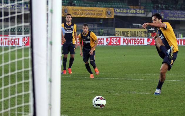 Hellas Verona forward Luca Toni scores on a penalty kick during a Serie A soccer match against Lazio at Bentegodi stadium in Verona, Italy, Thursday, Oct. 30, 2014