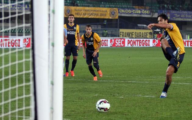 Hellas Verona forward Luca Toni scores on a penalty kick during a Serie A soccer match against Lazio at Bentegodi stadium in Verona, Italy, Thursday, Oct. 30, 2014