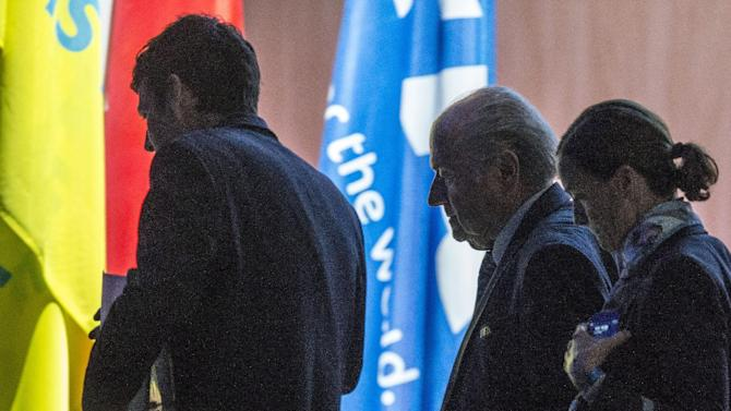 FIFA president Joseph S. Blatter, center, is on his way out for lunch during the 65th FIFA Congress held at the Hallenstadion in Zurich, Switzerland, Friday, May 29, 2015, where he runs for re-election as FIFA head. (Patrick B. Kraemer/Keystone via AP)