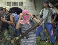 Abu Sayyaf gunmen guard a mosque in Bandang village, Jolo island in 2000. Seven Philippine soldiers were killed and 21 were wounded in fierce clashes with Al Qaeda-linked Islamic militants in the south of the country, the military said