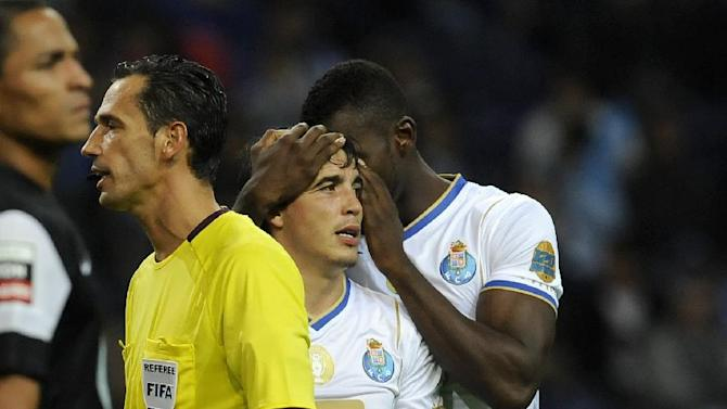 FC Porto's striker Jackson Martinez, right, from Colombia whispers in Josue Pesqueira's ear prior to a penalty against Vitoria Guimaraes in a Portuguese League soccer match at the Dragao Stadium in Porto, Portugal, Friday, Sept. 27, 2013. Josue scored the only goal in Porto's 1-0 victory