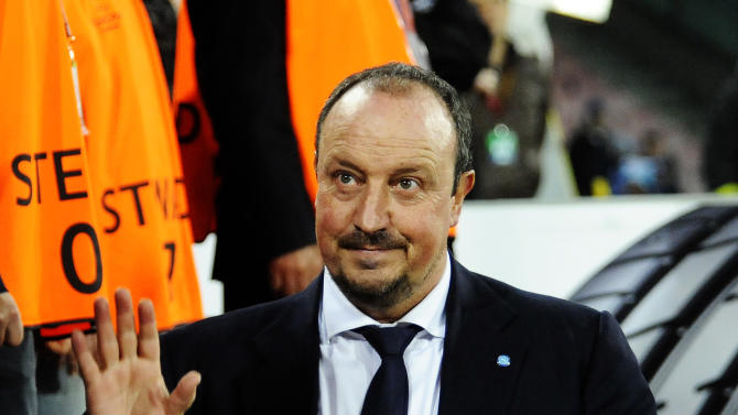 Napoli coach Rafa Benitez leaves the pitch at the end of the Europa League, round of 16 return-leg soccer match against Porto at the Naples San Paolo stadium, Italy, Thursday, March 20, 2014