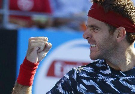 Juan Martin Del Potro of Argentina celebrates his win over top seed Fabio Fognini of Italy in their men's singles second round match at the Sydney International tennis tournament in Sydney