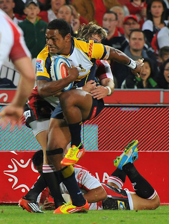 Brumbies' winger Henry Speight is tackled by a Lions' player during the Super 15 Rugby match between the Lions and Brumbies at the Ellis Park Stadium in Johannesburg, on April 27, 2012. AFP PHOTO/ ALE