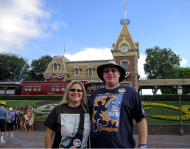 In this Sunday, July 1, 2012, photo, Jeff Reitz and Tonya Mickesh pose for a picture at the halfway point, day 183, in their mission to visit Disneyland in Anaheim, Calif., every day this year. Both were out of work when they decided that instead of moping at home, they would cheer themselves up with a challenge — going to Disneyland all 366 days in 2012. Mickesh now has a full-time job, but Reitz says she still joins him at night. (AP Photo/The Orange County Register, Mark Eades)