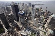 The skyscraper called Four World Trade Center, center, is seen above the September 11 Memorial and Museum, bottom center, Wednesday, Aug. 24, 2011 in New York. Developer Larry Silverstein is constructing Four WTC and two additional towers at the site. (AP Photo/Mark Lennihan)