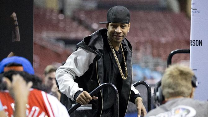 Former Philadelphia 76ers basketball player Allen Iverson arrives for a news conference Wednesday, Oct. 30, 2013, in Philadelphia. Iverson officially retired from the NBA, ending a 15-year career during which he won the 2001 MVP award and four scoring titles. Iverson retired in Philadelphia where he had his greatest successes and led the franchise to the 2001 NBA finals