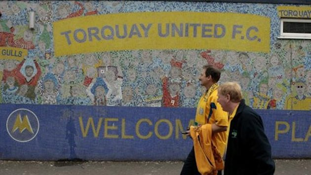 Fans outside the Plainmoor Ground, home stadium of Torquay United