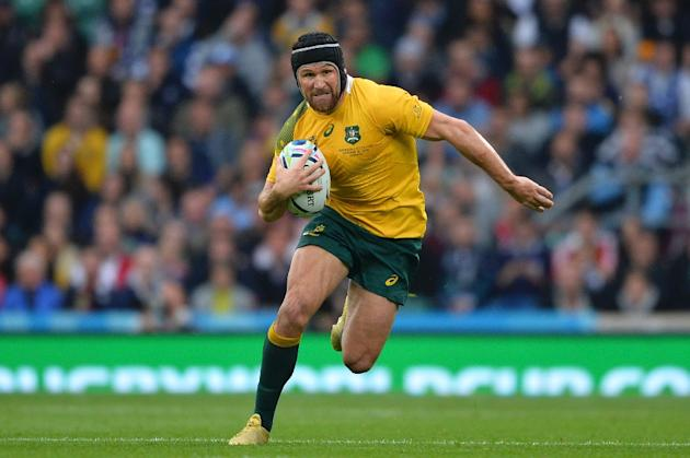 Matt Giteau, pictured on October 18, 2015, broke his ankle in the first-half of Australia's catastrophic 42-8 defeat to world champions New Zealand